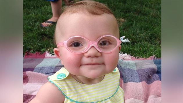 baby tries new glasses